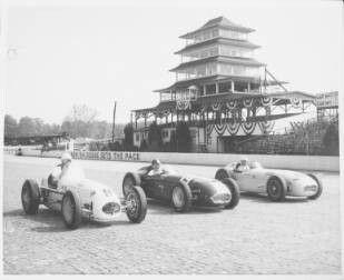 Jimmy Bryan, Jimmy Daywalt & Jack McGrath at Indy in 1954. Bryan on right.