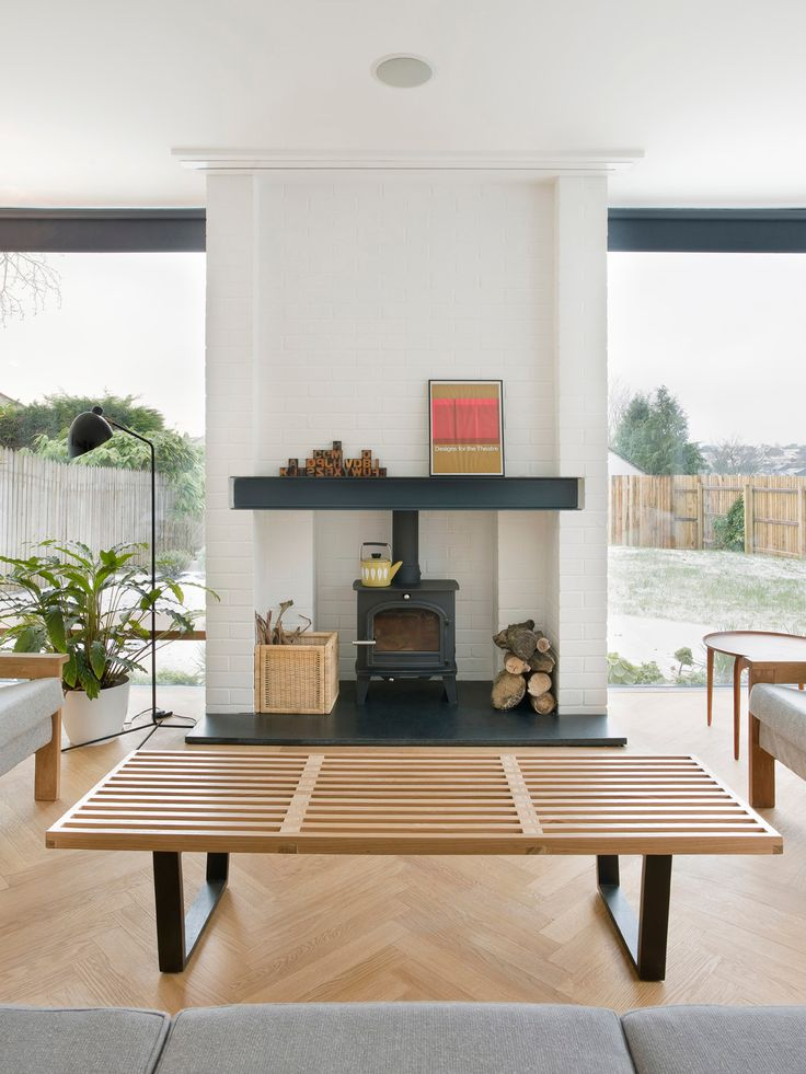 In southwest England, interior designer and avid furniture collector Kathryn Tyler built her home around the vintage pieces she'd amassed over a decade. In the living room, a Nelson bench doubles as a coffee table, and a wood-burning stove from Cleanburn Stoves keeps the space warm. Photo by Andrew Meredith.