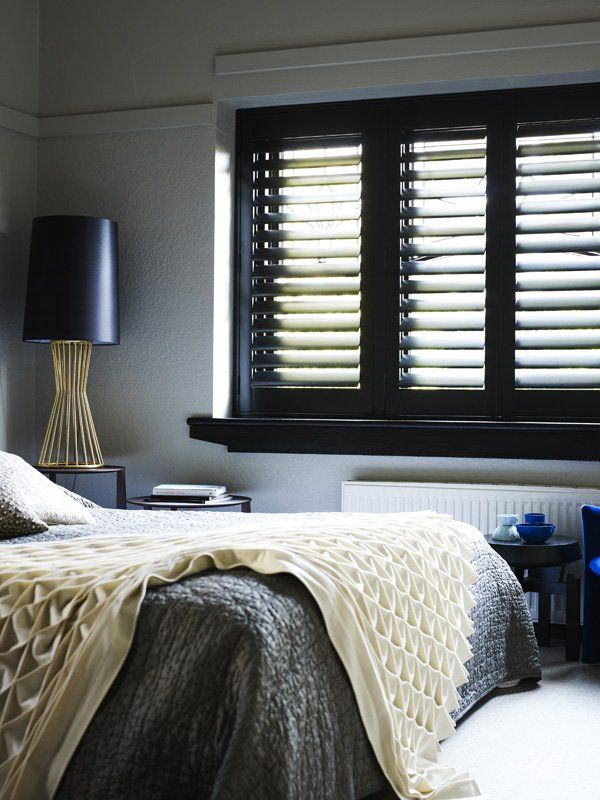Black interior shutters (homedit.com)