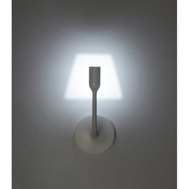 A contemporary back lit design LED wall light in a powder coated white finish. This unique style of wall light illuminates the surface it's mounted on in the shape of a traditional lamp shade, an abstract look that would be ideal for lighting in a contemporary lounge or bedroom for a decorative ambient lighting effect. Being LED lit also means it's very energy efficient using only 3 watts.