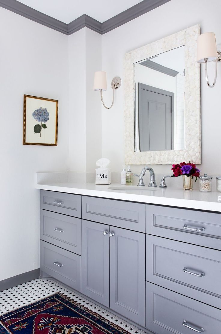 Soft grey vanity design along with grey crown molded ceilings ...