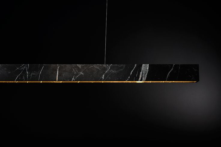 U Stone pendant lightin Nero Marquina by Belgian company ZUMI. Made from a single block of marble.