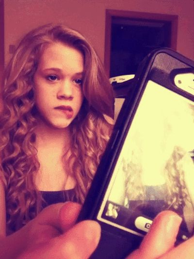 Spending hours and hours trying to get the perfect selfie. | 11 Of The Dumbest Things You Do With Your Phone