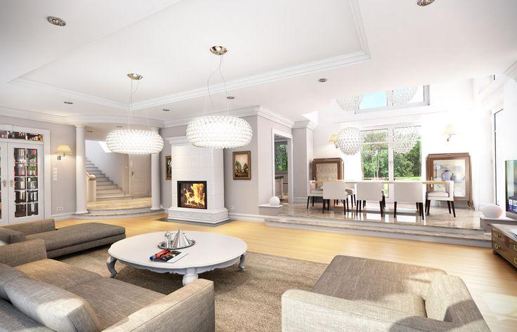 Tak prezentuje się salon z kominkiem w projekcie domu Willa Anna Maria…