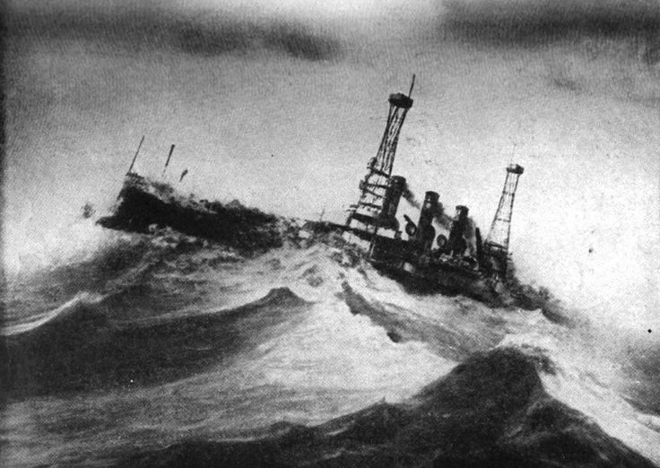 USS Vermont (BB-20) in a storm in the Atlantic Ocean in December 1913 as taken by an observer on board USS Wyoming (BB-32).