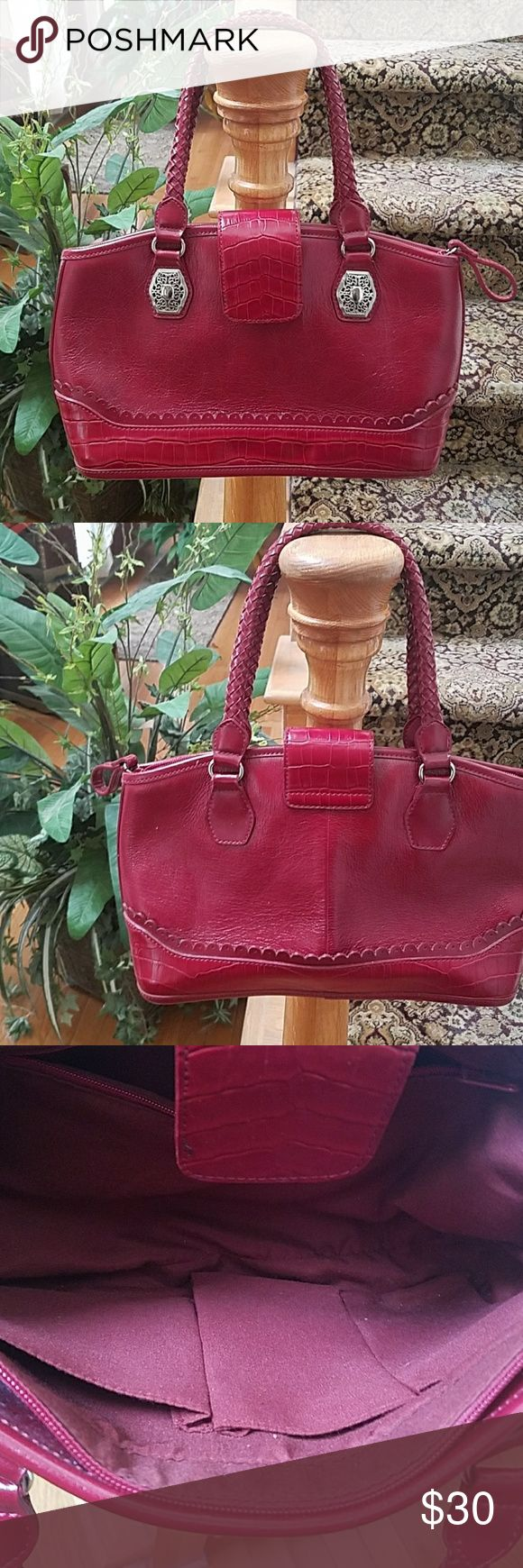 TUCKED AWAY IN A CLOSET RED HANDBAGS This nice bag has been tucked away for years. Clean inside and out. Has a zipper and 3 inside pockets. Magnetic closure outside. It's a medium size bag. The hardware is silver. Bags
