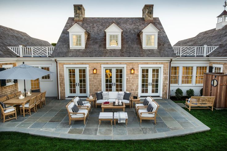 We wrap up our #pintour with a look at the gorgeous back patio.  Perfect for entertaining, the patio is a natural extension of the great room, dining room, and kitchen, providing a casual place to lounge, dine and enjoy New England summers. #HGTVDreamHome