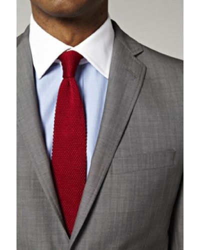 light grey suit light blue shirt with white collar red