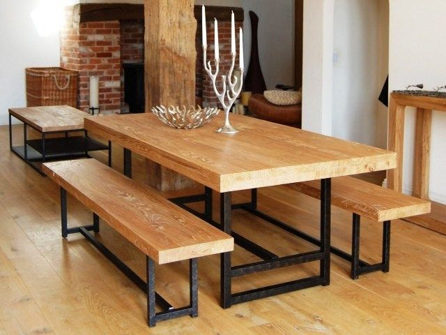 rectangular reclaimed wood table black iron base with benches on rustic floor in rustic restaurant furnishing ideas