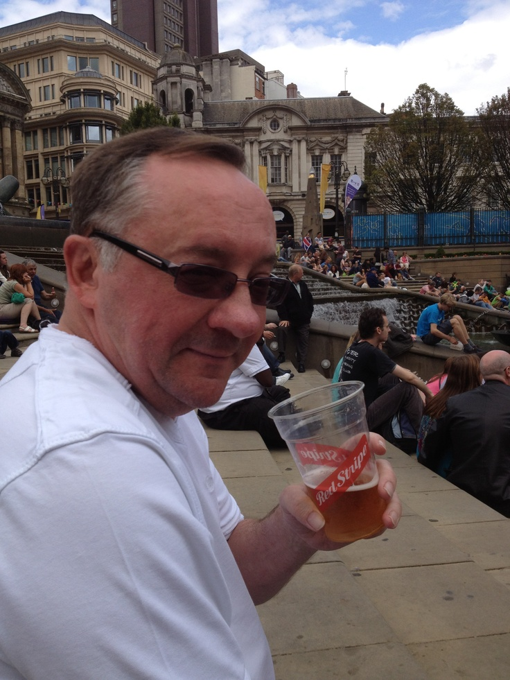 Ian drinking Red Stripe in Victoria Square, Birmingham during Jamaica Independence Day celebrations