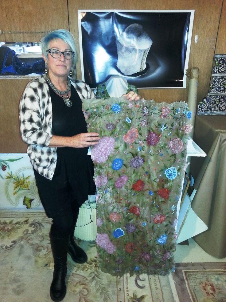Glass Artist Denise Pepper in studio with artwork in progress
