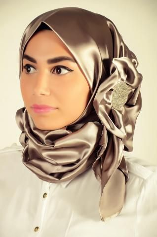 Turkish Party Hijab  This beautiful hijab is made especially for formal occasions. Gorgeously designed, it's adorned with satin flowers and Swarovski crystals.