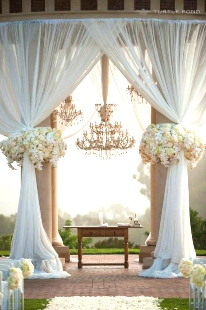 decorating ideas for outside wedding ceremony%0A outside wedding decor  flowers  a curtain and a gorgeous chandelier
