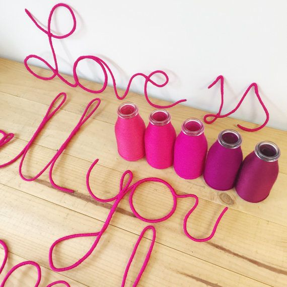 Yarn wrapped bottles & wire sign by The Colour Curator. Perfect little splash of colour for your next festive event.   Contact directly for customised designs. Instagram @thecolourcurator.