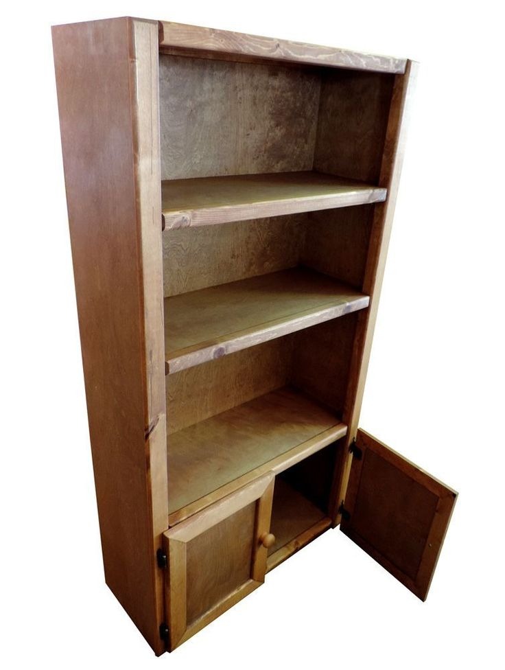 Kids Bedroom Bookshelf. Storage bed in action. Captains Bedroom Set in Amber Wash by Rustic Classics on www.GoWFB.ca. Four under-bed storage drawers provide room for clothes, toys and other items. Can include platform twin bed or full bed, dresser, mirror, nightstand, chest, desk & hutch, bookcase and a toybox. #furniture #canada #wholesale #kidsfurniture #bedroomsuite #storagebed