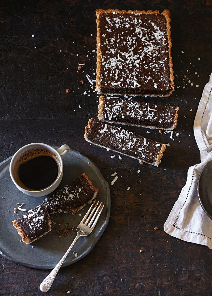 Chocolate caramel slice with macaroon crust