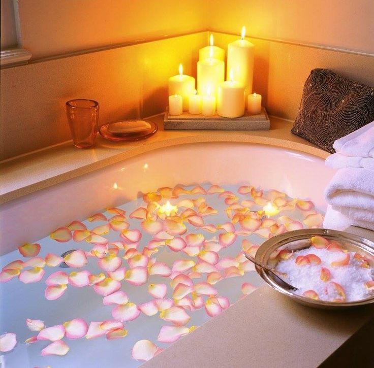 Petals of roses in the tub,candles,perfect for a relaxin romantic day.