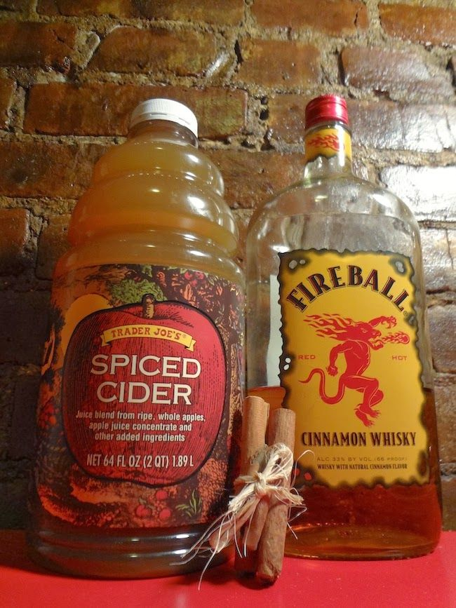 Easy Christmas Eve cocktail: Bottled apple cider & fireball whiskey. ~We serve this hot & also add a few Red Hot Candies to our mugs in my family :)