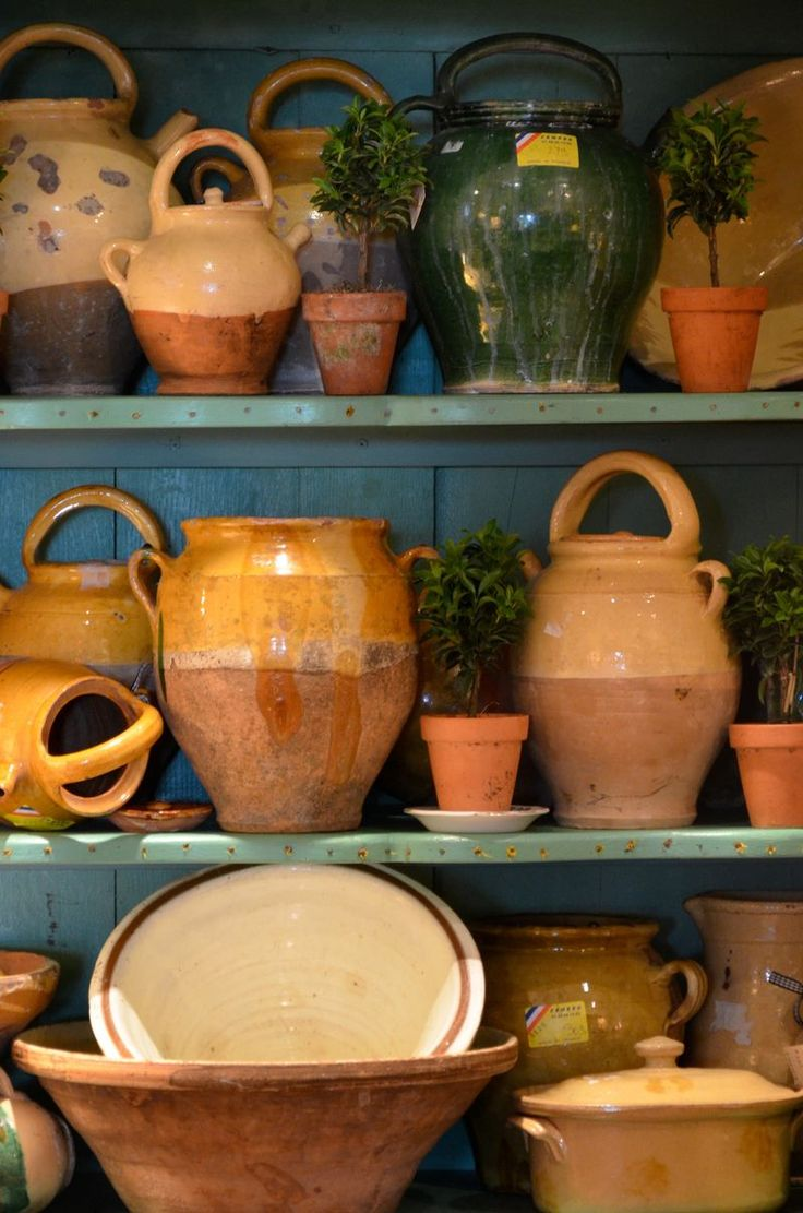 French earthenware pots, 19th century slipware water jugs, confit jars and pancheons.