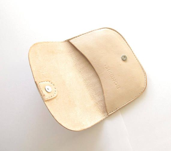 Heres a new design, a minimalist nude leather wallet.  Its just the right size for your Canadian or American bills folded once, and your cards. There is an inside pocket (made of metallic gold sort of plastic looking leather) for cards which will hold five or six cards. Small magnet