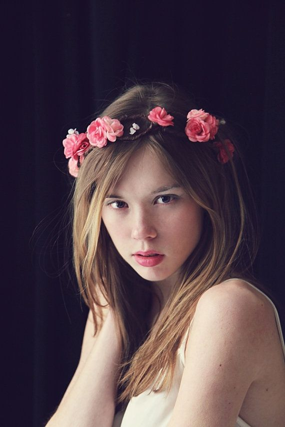 A whimsical statement headpiece, dance around like a nymph in the woods with this gorgeous flower crown. Stunning flowers in various colors