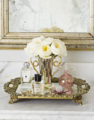 a mirrored vanity perfume tray--reminds me of a tray my mom used to have on top of her bedroom bureaus in the 1970s. It was square with gold scalloped edges!