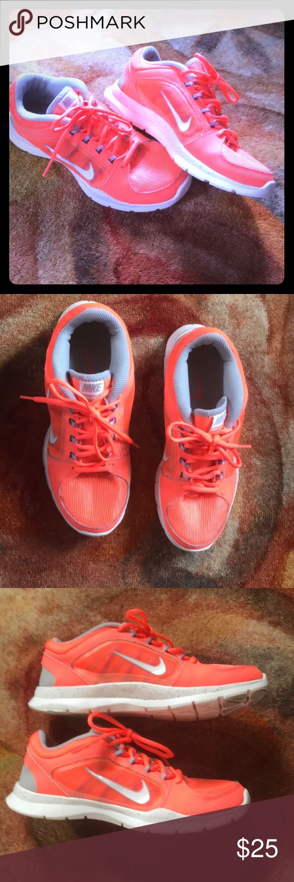 Nike Training shoes Bright neon orange Nike training shoes. Very fun color. Great condition only wore a handful of times. Small blemish on front of left shoe, as seen in photos, not noticeable when wearing. Size 7 and true to size. Shoes Athletic Shoes