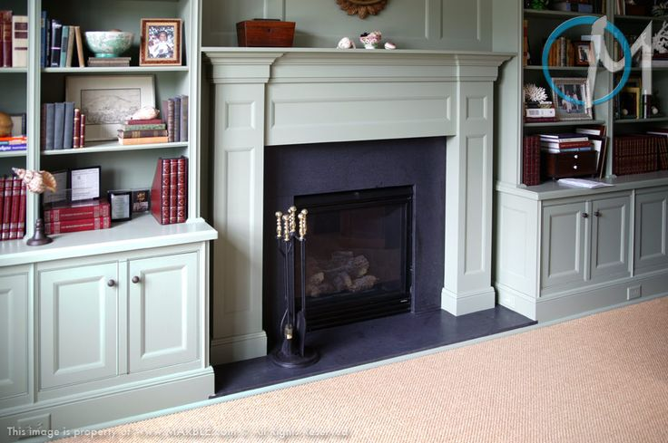 This fireplace uses Absolute Black Honed against pale green cabinetry.