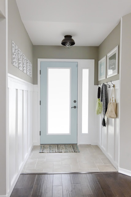 Jenna Sue....LOVE the coat rack to the right of the door with the artwork hanging above.
