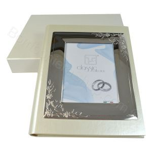 Silver Wedding Anniversary Album featuring a silver photo frame set into the first page. A great idea for a special 25th anniversay #present #gift http://www.bombonierashop.com/en/department/11/Gold-and-Silver-Wedding-Anniversary-Favours.html