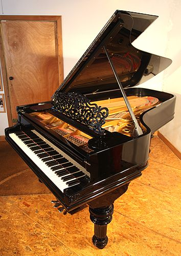 An 1882, Steinway Model C grand piano with a black case and turned, fluted legs at Besbrode Pianos. This piano belonged to Russian Princess Olga Romanov from the House of Holstein-Gottorp-Romanov. The piano was originally delivered to the Russian embassy in Finland.