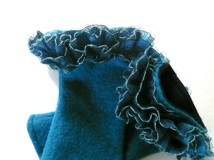 Petrol teal arm warmers, ruffled border, felted wool with black cotton lining, ruffles from woven yarn. $43.00, via Etsy.