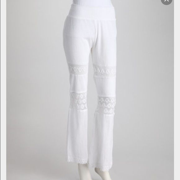 White Beach Pants Super cute! worn once to the beach and got some stains on waistline and hem but mostly unnoticeable Pants