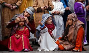 Children take part in a re-enactment during Good Friday in Bensheim, Germany.
