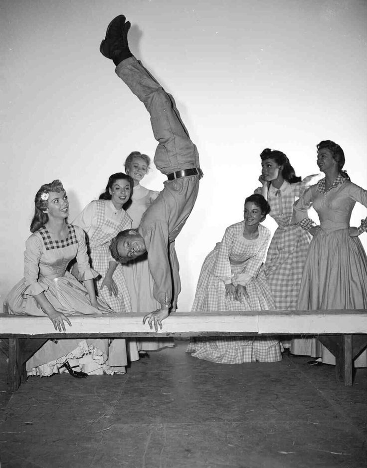 Russ Tamblyn showing off his acrobatic skills on the set of Seven Brides for Seven Brothers!:)