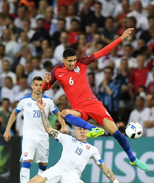 England 0 Slovakia 0 in 2016 in St Etienne. Chris Smalling clears from Juraj Kucka in Group B at Euro 2016.