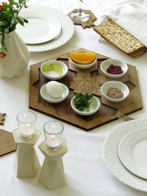An original gift for Passover - an innovative 2 in 1 set: a wooden Seder plate, with white ceramic bowls and a set of 6 pomegranate shaped coasters for wine cups,with star of david ornanament pattern at the center. An oiginal wedding gift.  This geometric modern Judaica piece combines two celebritive function of Pesach - serving the simbolic foods of the Seder, and decorating the table with a coasters for wine cups. designed in a pomegranate shape, the coasters inserted in the plate like a…