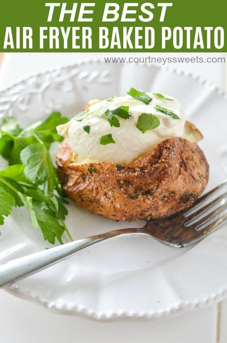 Air Fryer Baked Potato covered with a parsley garlic salt rub. Making Air Fryer Baked Potatoes will be your new favorite way to use your air fryer. #airfryer #airfryerrecipes #bakedpotato #potatoes #potato #sidedish via @CourtneysSweets