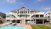Lindenwood - N035 is an Outer Banks Oceanfront vacation rental in Ocean Hill Corolla NC that features 9 bedrooms and 9 Full 2 Half bathrooms. This pet friendly rental has a private pool, an elevator, and a pool table among many other amenities. Click here for more.