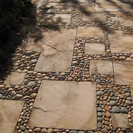 A hodge-podge collection of salvaged concrete pavers are combined with pebbles and river rocks to create a mosaic-like garden path. - See more at: http://www.home-dzine.co.za/garden/garden-reclaimed-wood-path.htm#sthash.DsQM2y36.dpuf