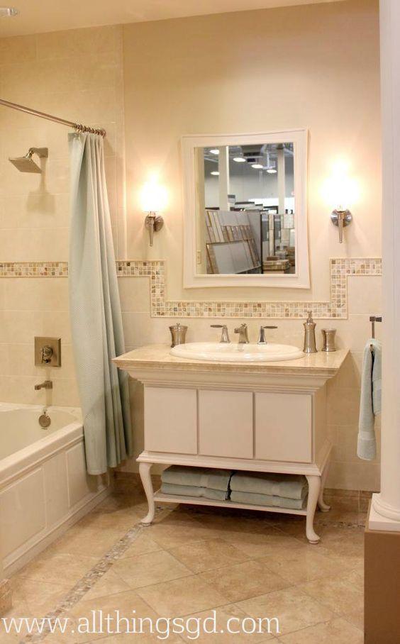 Neutral Tiled Bathroom   Tiled Border On The Floor With Similar Tiled  Border Along The Wall, Framing The Mirror For Added Interest
