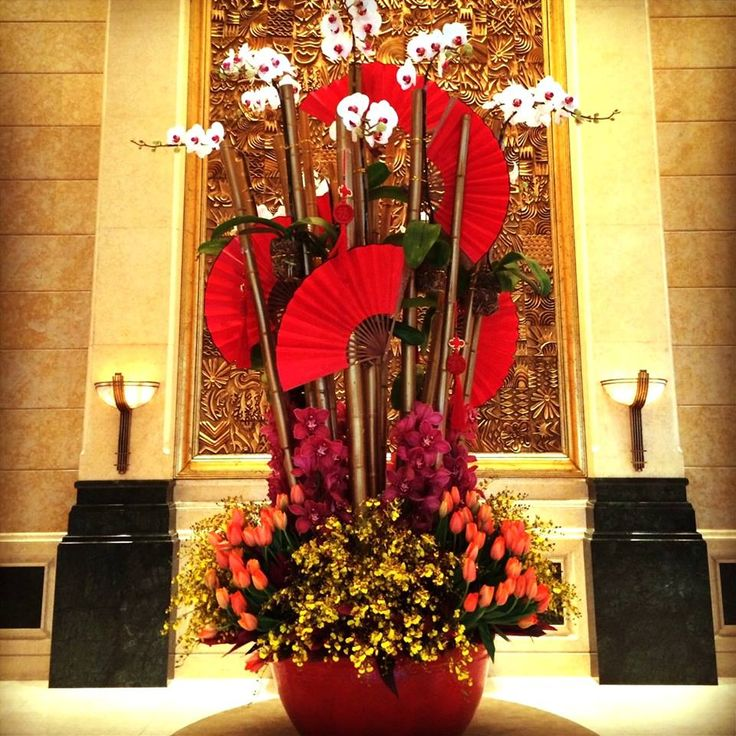 Crimson Chinese New Year flowers in the lobby of Four Seasons Hotel Shanghai herald the Year of the Horse.