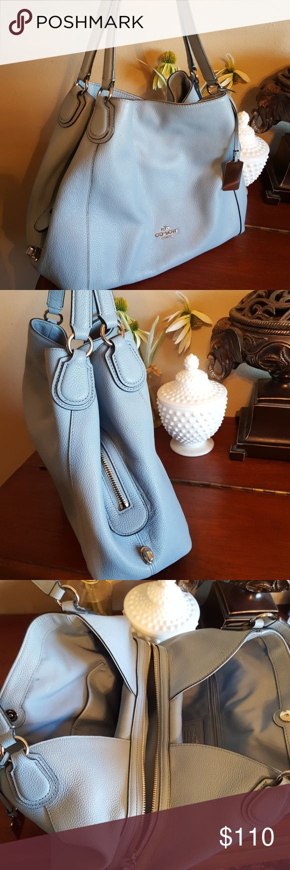 COACH Blue Shoulder Bag Beautiful baby blue pebbled leather Coach shoulder bag in great condition! There is a small mark on the inside lining per photo #5, and the silvertone hang tag has a few scratches in it, other than that it looks wonderful. Arrives in brand new generic white dust bag (not a Coach dust bag).  Price firm. Coach Bags Shoulder Bags