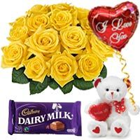 """12 Yellow Roses Bouquet with 6"""" Teddy with a balloons and Dairy Milk Chocolate Bar"""