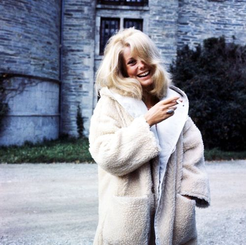 Catherine deneuve and a great smile.  The coat's not bad either.  Catherine Deneuve, 1963  i love her coat