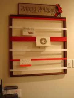 DIY Christmas Card Holder.  I love this idea!  I am one of those (call me lazy) people that leaves the cards up all year long - literally.  I have them hanging with clothespins on a row of Christmas patterned cloth hearts in our living room.  I love seeing them hanging there -  all the pics of family and friends as well as the little reminders that someone loves us!
