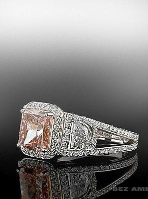 Fancy Intense Orange-Pink Ring with half moon side stones and diamond pave. Bez Ambar.  Available at Alson Jewelers.
