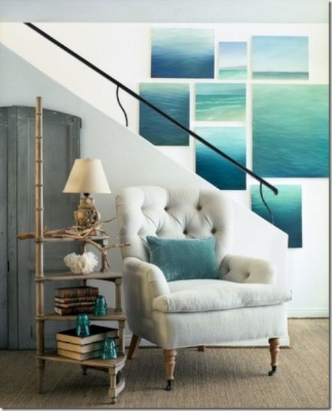 WOW....I LOVE THIS IDEA.....WOULD BE COOL IN YOUR SPARE BEDROOM........inspired by the sea / a wall of sea paintings and a great circular step stool used as a side table