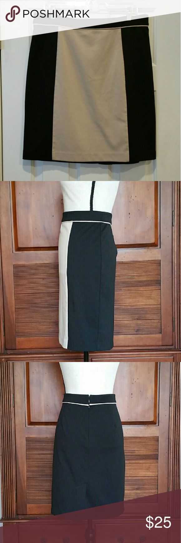 "Dana Buchanan Color Block Skirt Dana Buchanan Color Block pencil Skirt in black and tan *Pic 1 hanging shows actual porportion color block fit at size 14 ( mannequin is sz 6/8 ) medium weight poly rayon spandex blend zipper back with eye hook tan piping accent front to back around waistline length measures aprox 23"" EUC Dana Buchman Skirts Pencil"