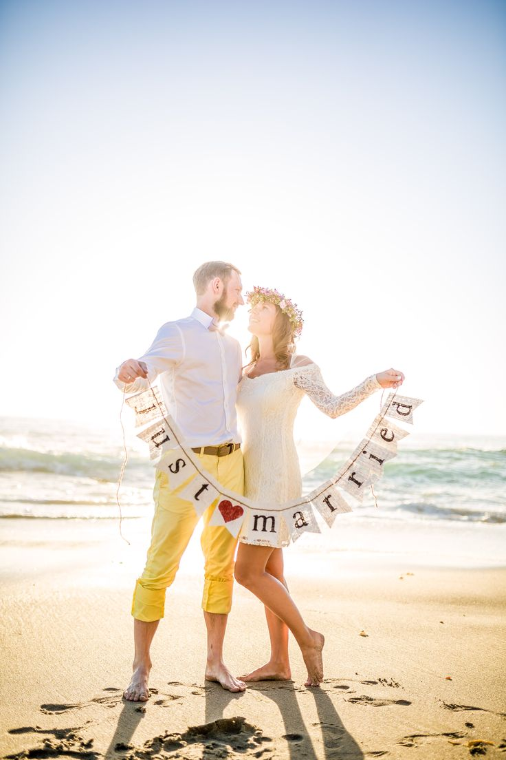 Love the idea of the sign! View the full wedding here: http://thedailywedding.com/2016/01/26/laguna-beach-elopement-vigita-andruis/